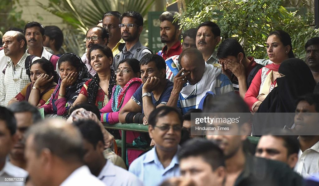 Parents of students waiting for their children at the examination centre for 'National Eligibility Entrance Test' (NEET) exam for admissions to MBBS and BDS courses, at DPS School R K Puram, on May 1, 2016 in New Delhi, India. She was not allowed to enter the examination hall. The Supreme Court had on Saturday said that the entrance test for admission to MBBS and BDS courses for the academic year 2016-17 will be held as per the schedule through the two-phased common entrance test NEET on May 1 and July 24.