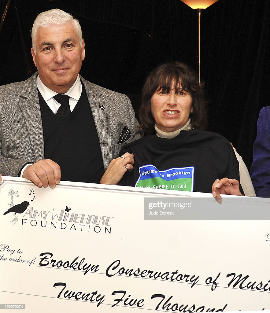 Parents of the late Singer Amy Winehouse, Mitch Winehouse and Janis Winehouse, present a donation from the Amy Winehouse Foundation to the Brooklyn Conservatory of Music on January 16, 2013 in the Brooklyn borough of New York City.