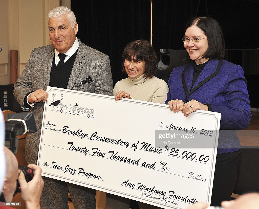 Parents of the late singer Amy Winehouse, Mitch Winehouse and Janis Winehouse, with Brooklyn Conservatory of Music Executive Director Karen Geer attend the Amy Winehouse Foundation grant presentation at the Brooklyn Conservatory of Music on January 16, 2013 in the Brooklyn borough of New York City.