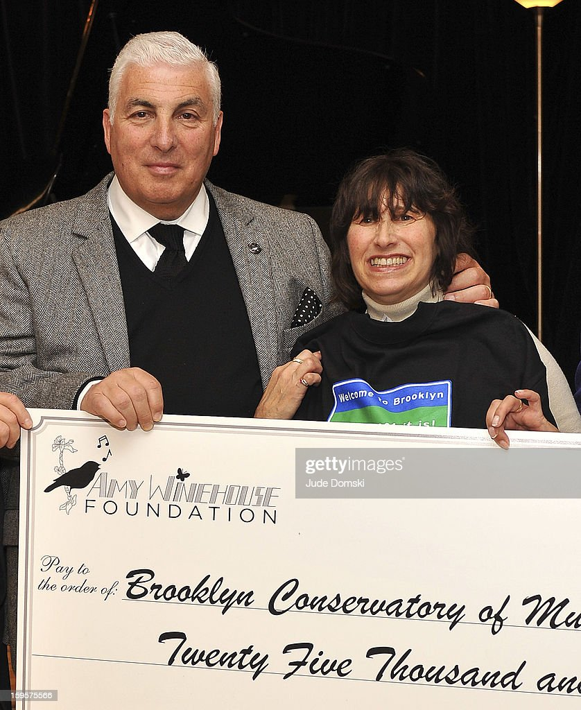 Parents of the late singer Amy Winehouse, Mitch Winehouse and Janis Winehouse, present a check from the Amy Winehouse Foundation to the Brooklyn Conservatory of Music on January 16, 2013 in the Brooklyn borough of New York City.