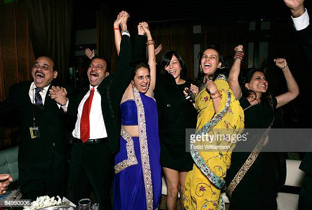 Parents of the Slumdog Millionaire kid actors celebrate as Slumdog Millionaire wins an Academy Award for Best Picture attend the Fox Searchlight...