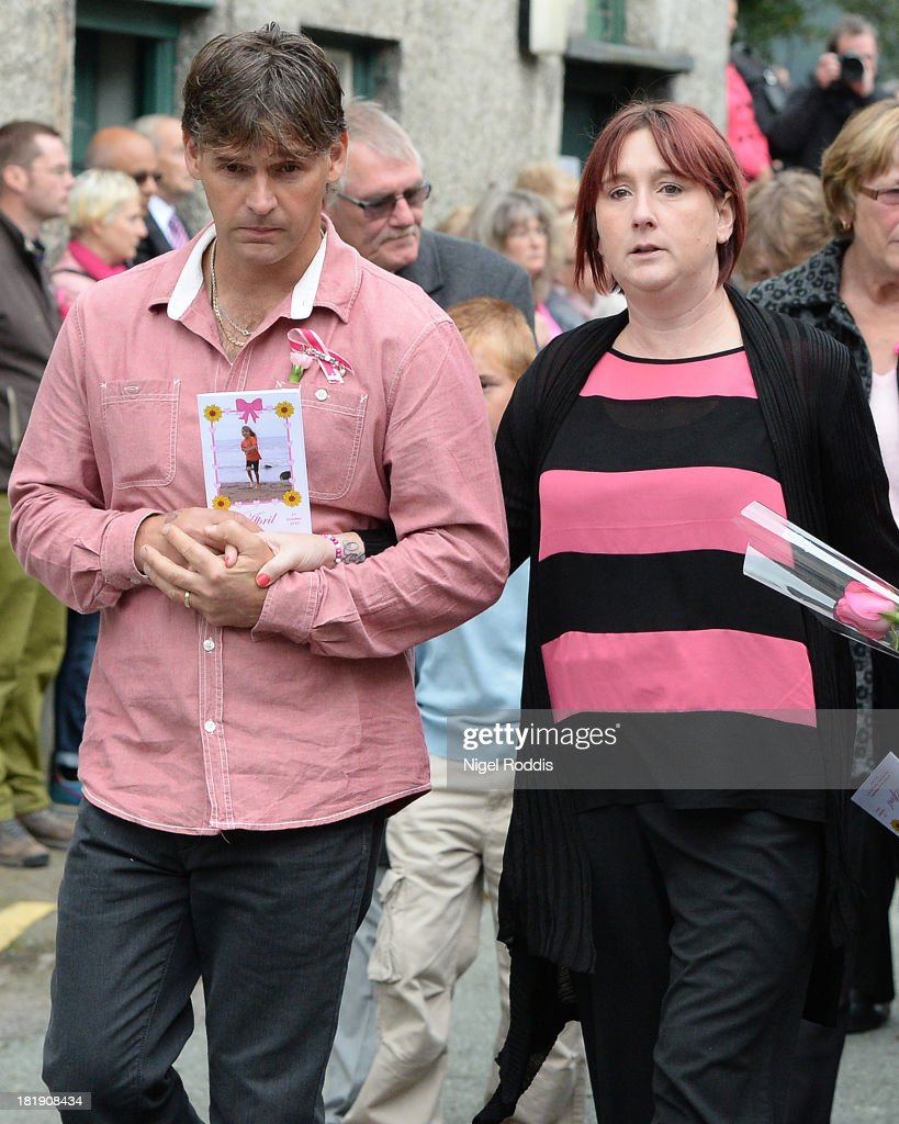 Parents Paul Jones and Coral Jones hold hands as they leave after the funeral of their daughter, murdered schoolgirl April Jones at St Peter's Church on September 26, 2013 in Machynlleth, Wales. Local man Mark Bridger, aged 47, was found guilty of abducting and murdering five-year-old April who went missing in Machynleth on October 1, 2012.