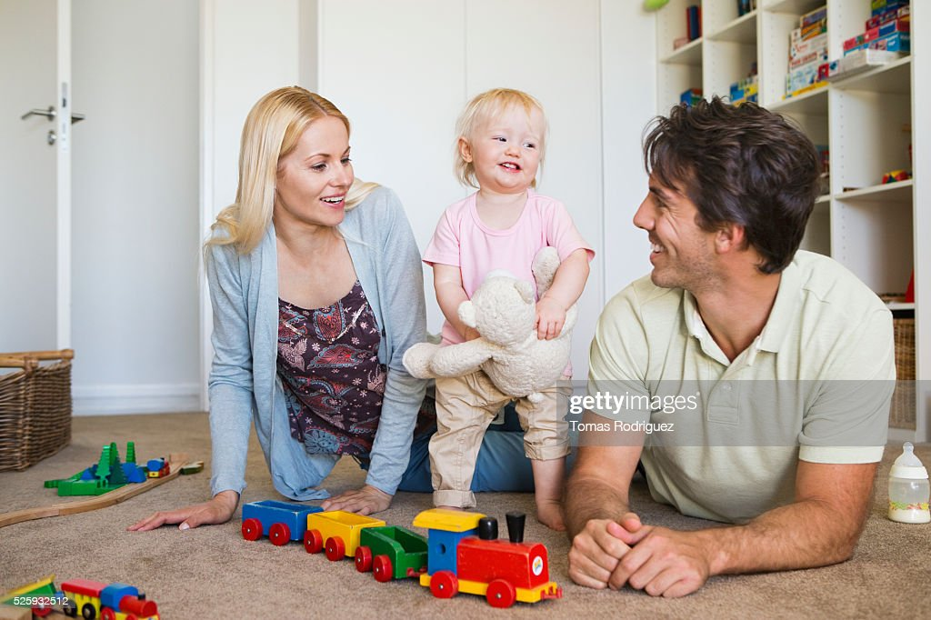 Parents playing with daughter (12-23 months) at home : Foto de stock