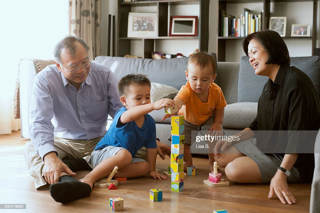 Parents playing with sons (6-11 months, 12-23 months)