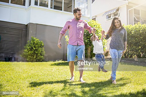 Parents playing with their son in garden