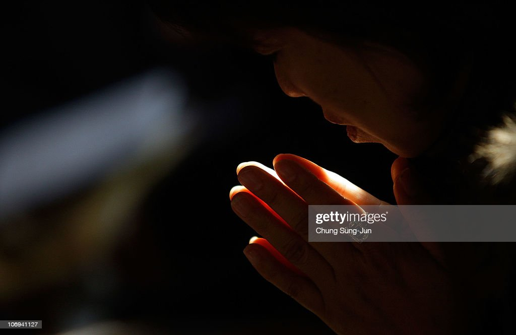 Parents pray for their children's success at the College Scholastic Ability Test at Chogye Buddhist temple on November 18 2010 in Seoul South Korea...