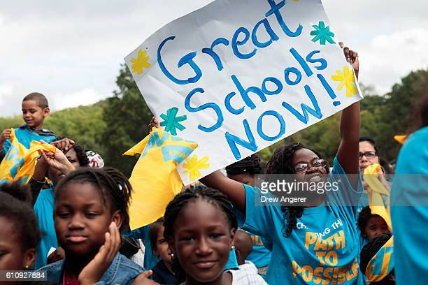 Parents schoolchildren and education activists rally during an event supporting public charter schools and protesting New York's racial achievement...
