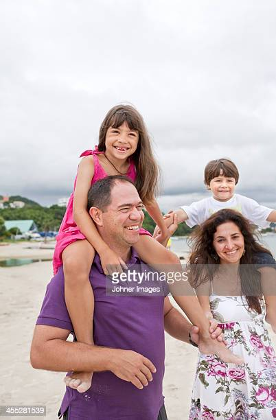 Parents son and daughter on beach