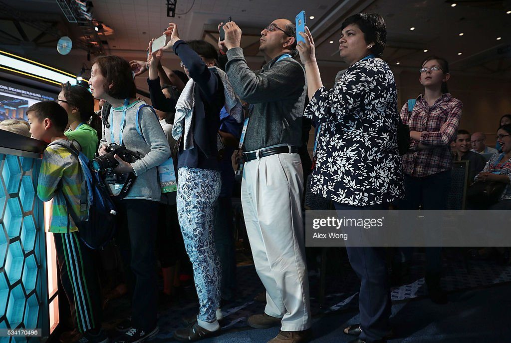 Parents take photos of their children on stage during the 2016 Scripps National Spelling Bee May 25, 2016 in National Harbor, Maryland. Students from across the country gathered to compete for the top honor at the annual spelling championship.