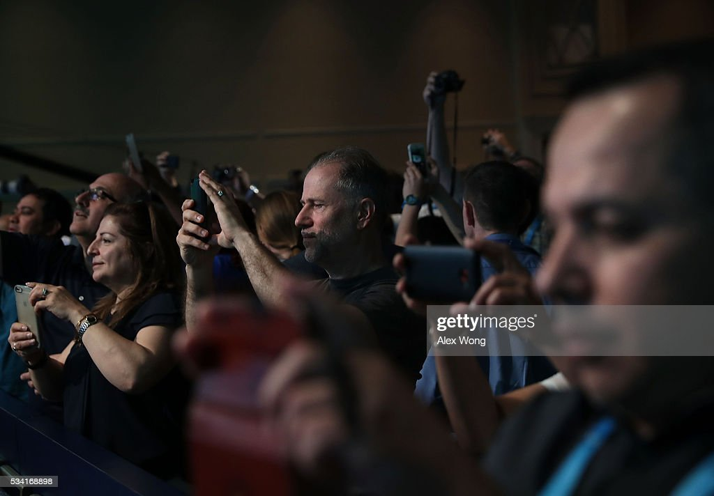 Parents take photos of their children who are participating in round two of the 2016 Scripps National Spelling Bee May 25, 2016 in National Harbor, Maryland. Students from across the country gathered to compete for the top honor at the annual spelling championship.
