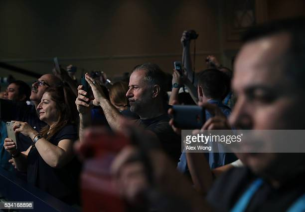 Parents take photos of their children who are participating in round two of the 2016 Scripps National Spelling Bee May 25 2016 in National Harbor...