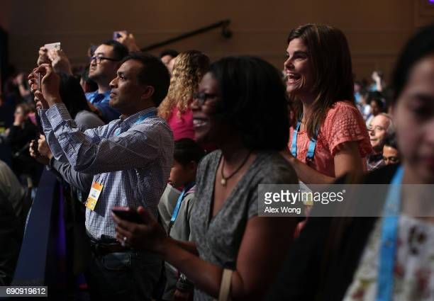 Parents take pictures of their children who are participating on stage in round two of 2017 Scripps National Spelling Bee at Gaylord National Resort...