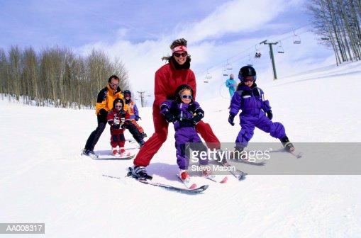 Parents Teaching Children to Ski : Stock Photo