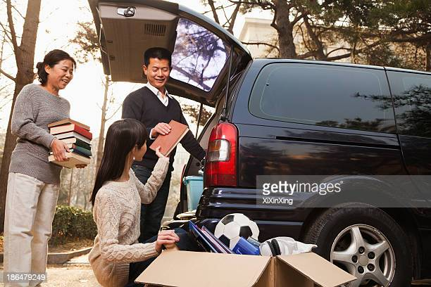 Parents unpacking car for a move to college, Beijing