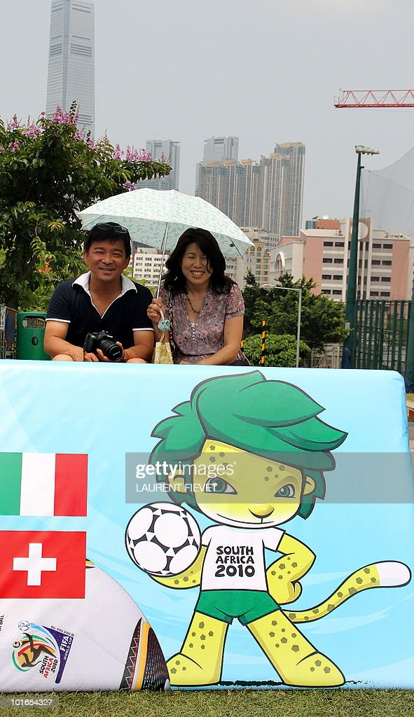 Parents watch young football players taking part in the Mini World Cup 2010 in Hong Kong on June 6, 2010. The South Africa 2010 World Cup will start on June 11.