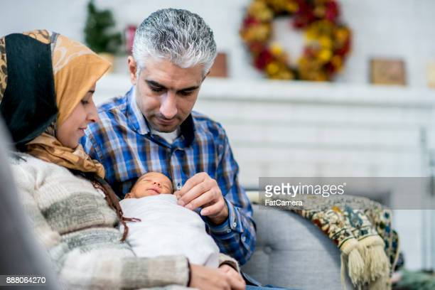 Parents Watching Their Newborn
