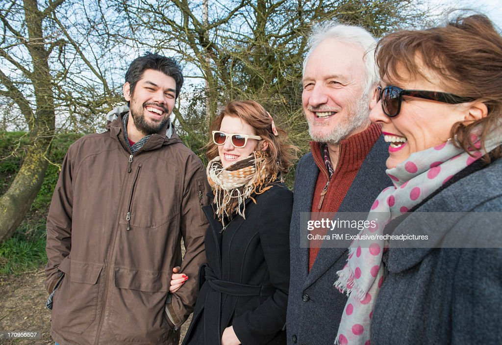 Parents with adult daughter and son in law : Stock Photo