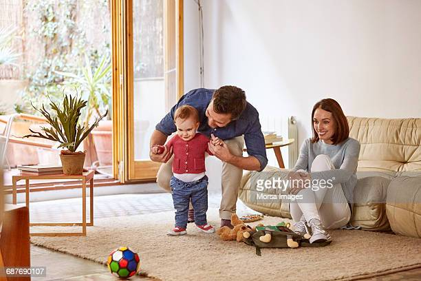 Parents with baby enjoying at home