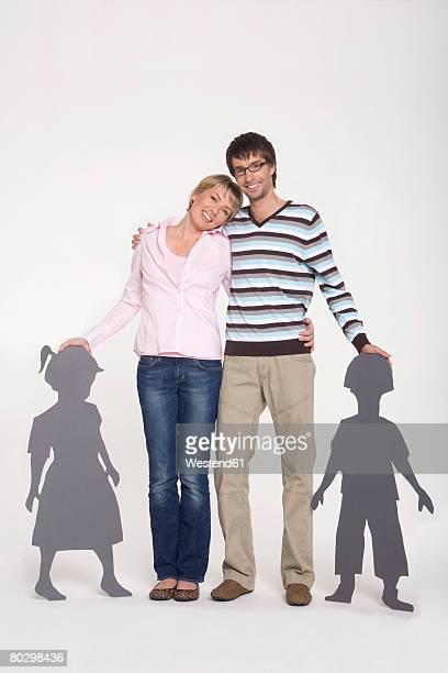 Parents with children, smiling, composite