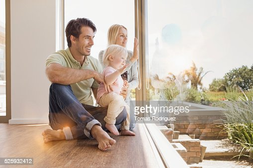 Parents with daughter (12-23 months) at home : Stockfoto