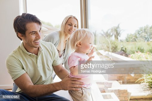 Parents with daughter (12-23 months) at home : Stock Photo