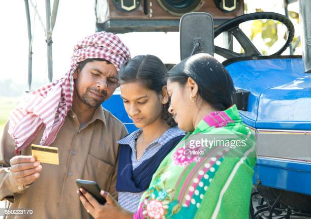 Parents with daughter shopping online