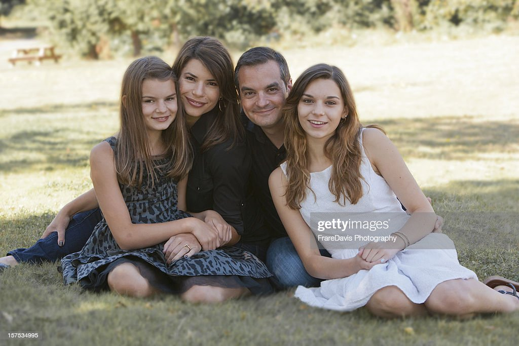 Parents with teenage daughters : Stock Photo