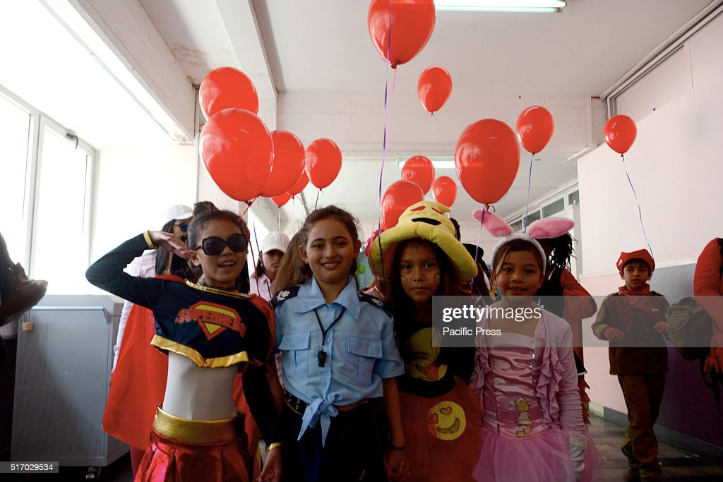 Parents with their children join the colorful parade of 'Purim' at the Bialik Rogozin School in Tel Aviv It is an educational campus that serves over...