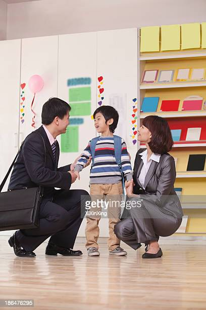 Parents with their Son in Classroom