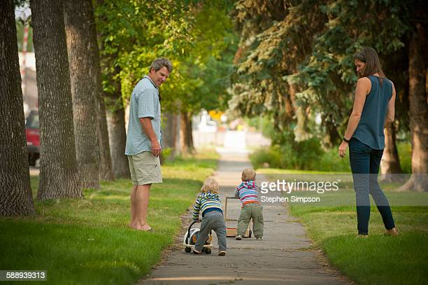 parents with twins on front sidewalk