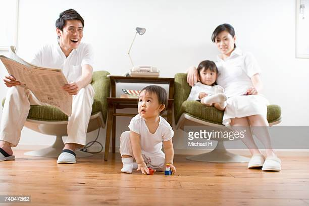 Parents with two children (4-5, 6-7) in living room