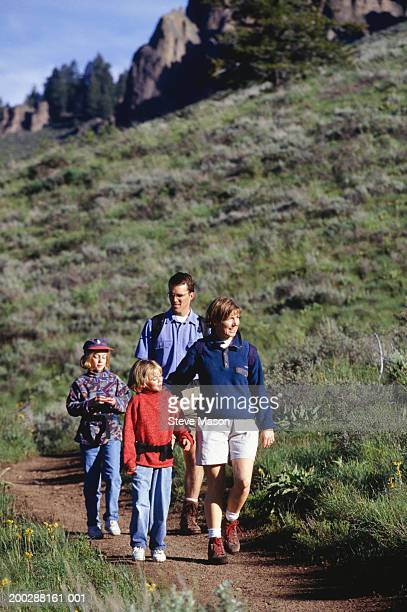 Parents with two daughters (4-5), (8-9) hiking in mountains