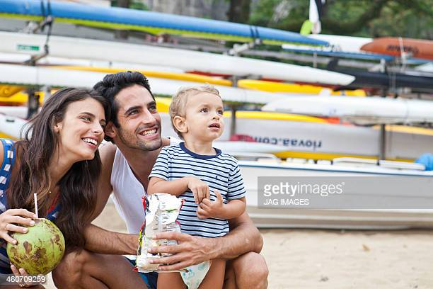 Parents with young son looking away, smiling