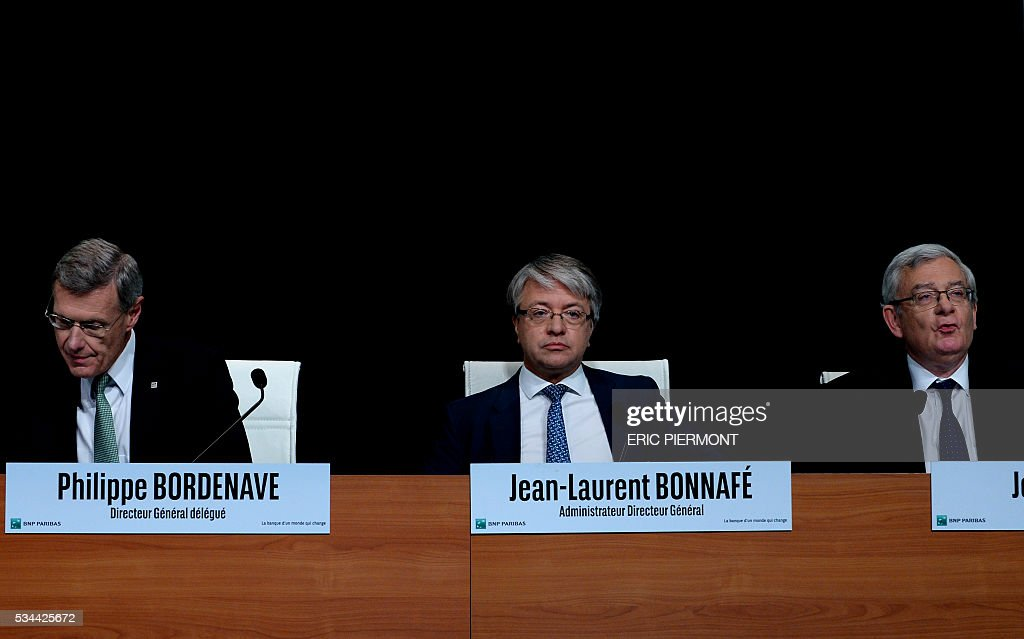 BNP Paribas Chief Executive Jean-Laurent Bonnafe (C) is flanked by Chairman of the Board of Directors Jean Lemierre (L) and Chief Operating Officer Philippe Bordenave (R) while arriving to address the group's general meeting in Paris on May 26, 2016. / AFP / ERIC