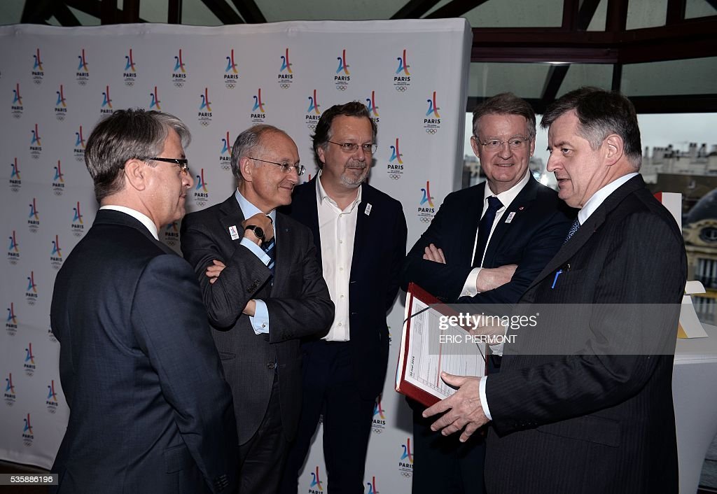 BNP Paribas Chief Executive Jean-Laurent Bonnafe,French group La Poste CEO Philippe Wahl, Elior CEO Philippe Salle, co-president of the French National Olympic and Sports Committee Bernard Lapasset and Paris airports ('Aeroports de Paris', ADP) group Chief Executive Officer Augustin de Romanet arrive to attend a meeting of French companies and official partners of Paris bid for the 2024 Summer Olympics in Paris on May 30, 2016. / AFP / ERIC