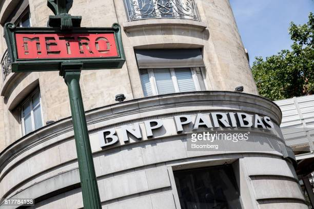 Paribas SA logo sits omn display outside a BNP Paribas bank branch in Paris France on Tuesday July 18 2017 BNP Paribas agreed to pay $246 million to...