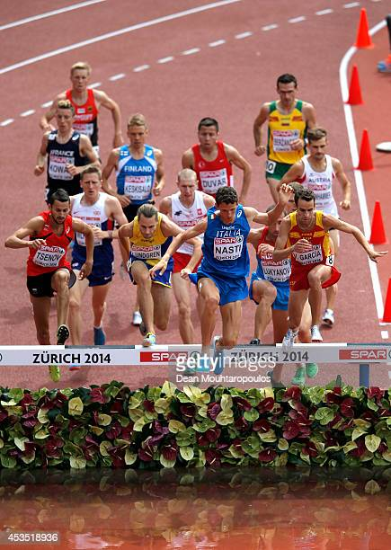 Parick Nasti of Italy clears the water jump ahead of the pack in the Men's 3000 metres Steeplechase heats during day one of the 22nd European...