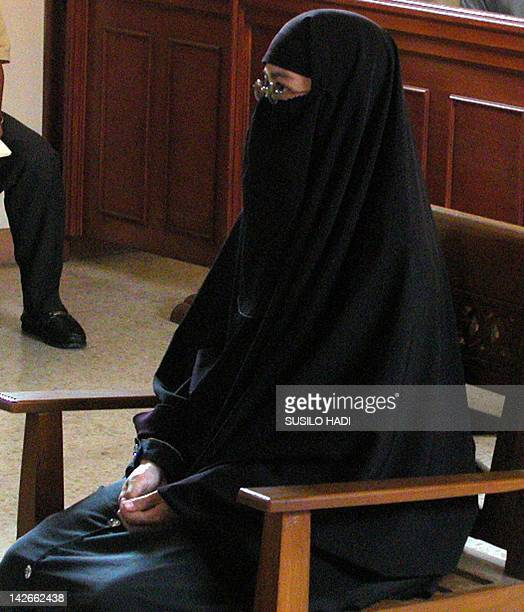 Paridah binti Abas the wife of Muckhlas one of the Bali bombing suspects sits during her trial at a court in Solo Central Java 17 March 2003 The wife...