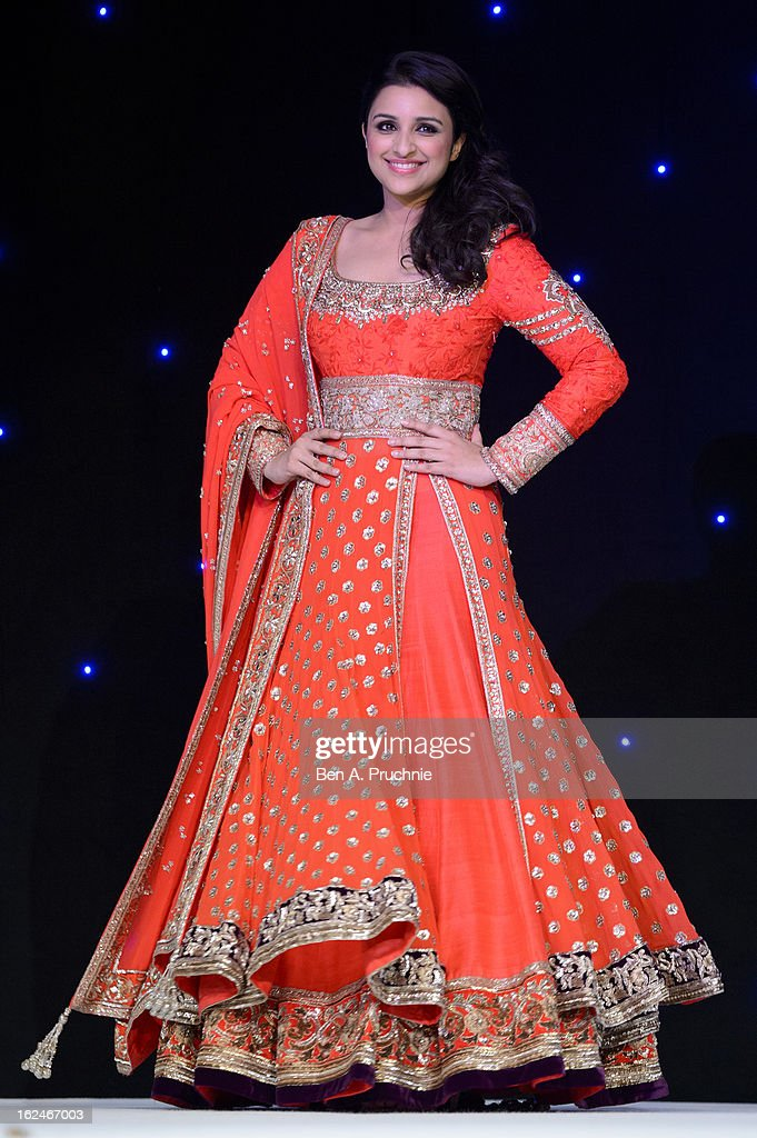 Parineeti Chopra walks in a catwalk show during a charity fundraising event hosted by Manish Malhotra in aid of 'Save the Girl Child' at The Grosvenor House Hotel on February 23, 2013 in London, England.