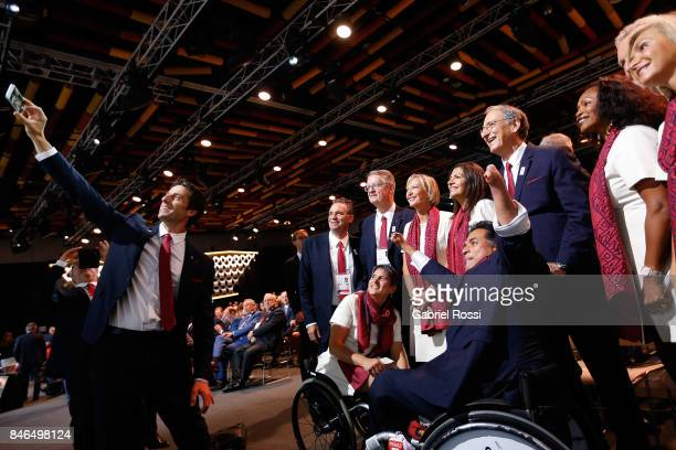 Paris 2024 Bid CoChair and 3time Olympic Champion Tony Estanguet takes a selfie with other Paris 2024 Bidding Committee members during the 131th IOC...