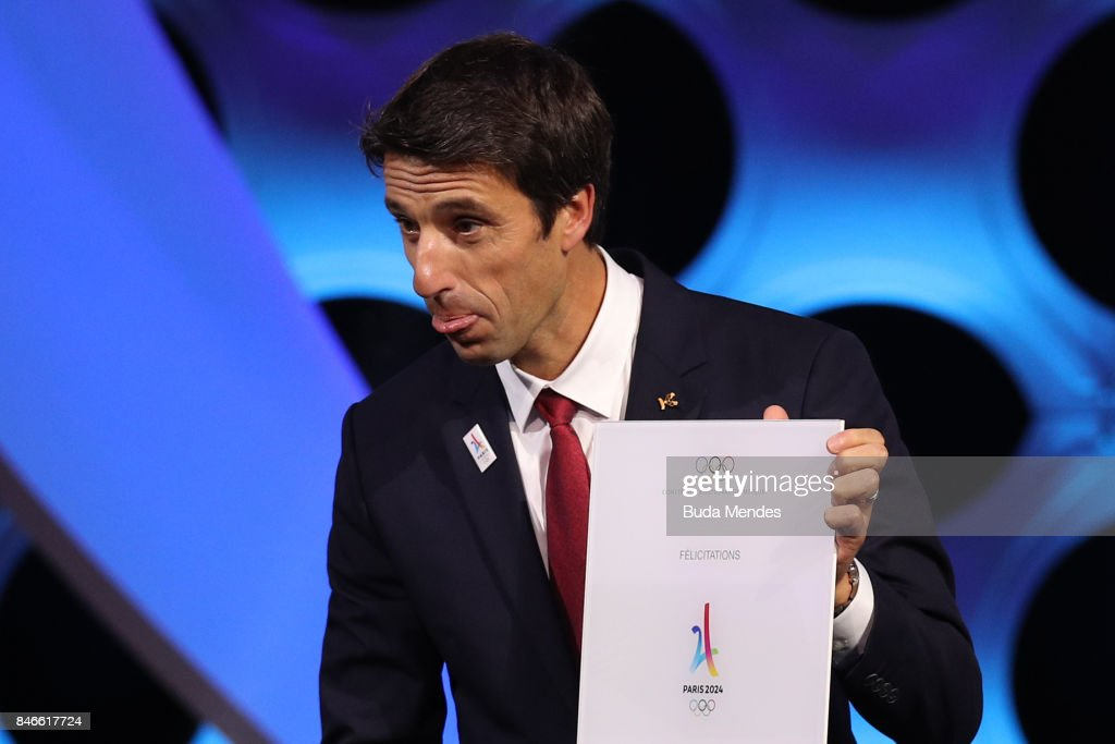 Paris 2024 Bid Co-Chair and 3-time Olympic Champion Tony Estanguet shows and IOC document during a joint press conference between IOC, Paris 2024 and LA2028 during the131th IOC Session - 2024 & 2028 Olympics Hosts Announcement at Lima Convention Centre on September 13, 2017 in Lima, Peru.