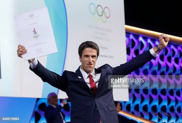 Paris 2024 Bid CoChair and 3time Olympic Champion Tony Estanguet shows the Host City agreement between Paris and IOC for 2024 Olympics during the...