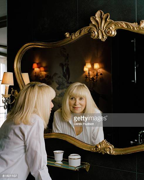 Actress Mireille Darc poses at a portrait session for Point de Vue in Paris on May 21 2008