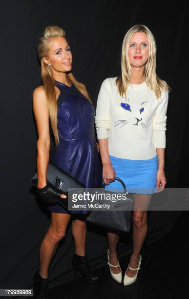Paris and Nicky Hilton attends the Charlotte Ronson Presentation during MercedesBenz Fashion Week Spring 2014 at The Box at Lincoln Center on...