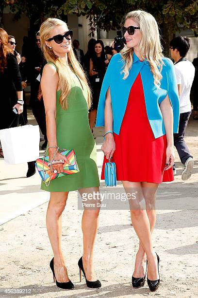 Paris and Nicky Hilton attends the Valentino show as part of the Paris Fashion Week Womenswear Spring/Summer 2015 on September 30 2014 in Paris France