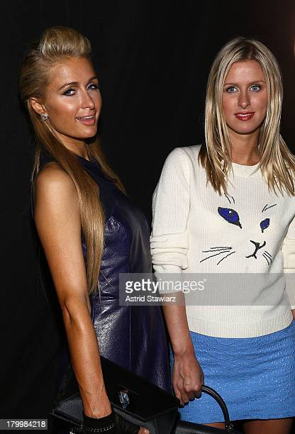 Paris and Nikki Hilton attend the Charlotte Ronson fashion presentation during MercedesBenz Fashion Week Spring 2014 at The Box at Lincoln Center on...