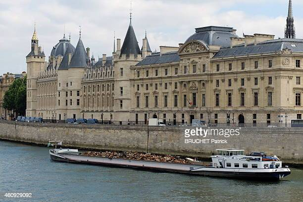 Paris and the Seine barge carrying scrap past the Conciergerie and the Court of Cassation Quai de l'Horloge in Paris on June 17 2014