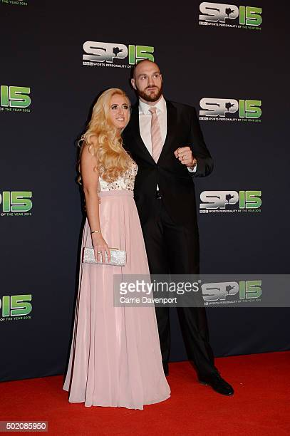 Paris and Tyson Fury pose on the red carpet before the BBC Sports Personality of the Year award at Odyssey Arena on December 20 2015 in Belfast...