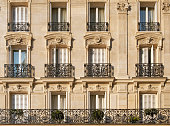 Typical facade of Parisian building near Notre-Dame