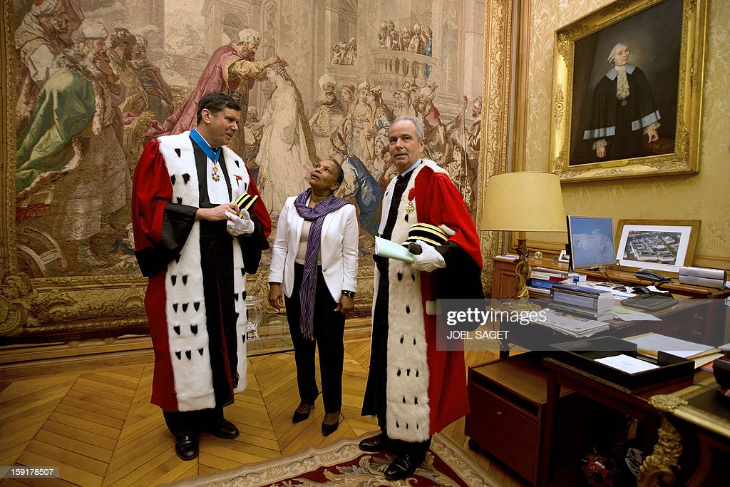 Paris' appeal court prosecutor Francois Falletti (L), French Justice minister Christiane Taubira (C) and Paris' appeal court first president Jacques Degrandi (R) arrive to attend a formal sitting of Paris' appeal court, on January 9, 2013, at the Palais de Jusctice in Paris, to mark the beginning of the Court's judicial year.